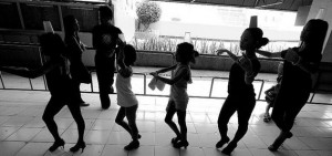 The dancers are made to walk with cups on their heads to improve posture and balance outside the Cebu City Dancesports Studio. A large portion of their practice time is devoted to maintaining correct posture and balance.